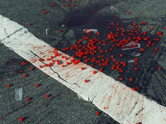 USA. New York City, NY. 2014. Cherries spilled on crosswalk. Christopher Anderson Magnum Manifesto