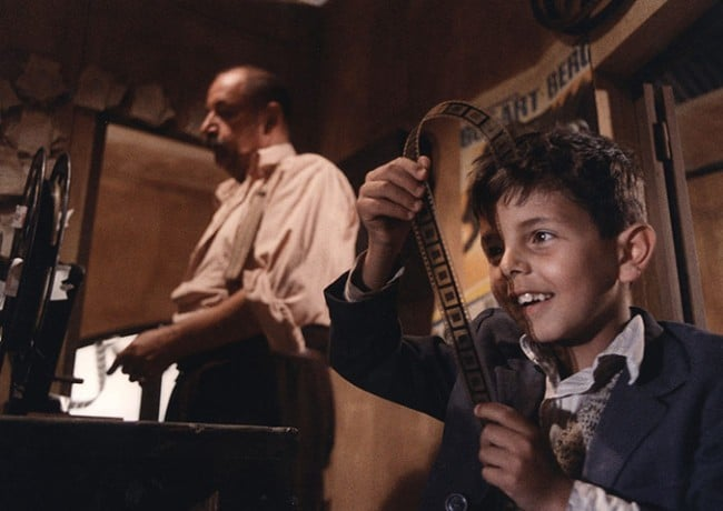 Cinema Paradiso: Salvatore looks at film negatives in the projector