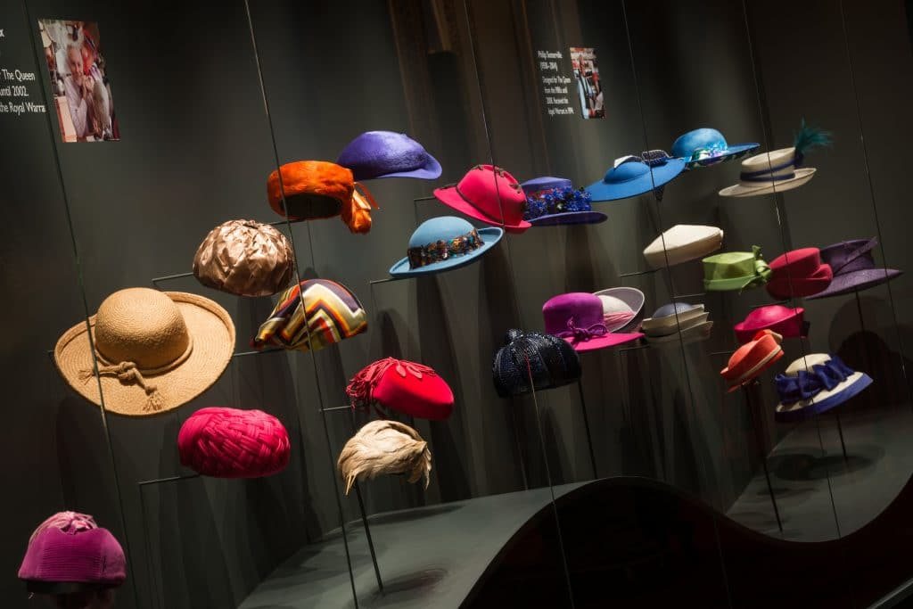 A display of The Queen's hats from Fashioning a Reign: 90 Years of Style from The Queen's Wardrobe at Buckingham Palace