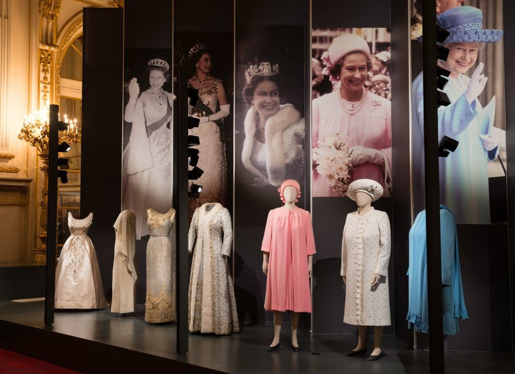 A display of dresses from Fashioning a Reign: 90 Years of Style from The Queen's Wardrobe on display at Buckingham Palace. Images for use only in connection with the exhibition Fashioning a Reign: 90 Years of Style from The Queen's Wardrobe at the Summer Opening of Buckingham Palace